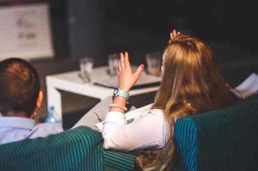 behind of woman gesturing
